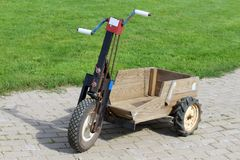 Old carved wheelbarrow. Old self-developed wheelbarrow for heavy duty transport stock images