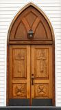 Old carved wooden church door with lantern Stock Photos