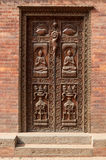 Old carved wooden door in Kathmandu, Nepal Royalty Free Stock Image