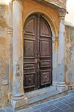 An old carved wooden door in the old town of Rhodes. Brown door in Greece Royalty Free Stock Images
