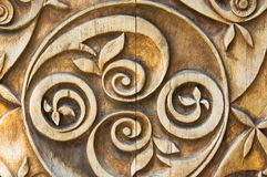 Old carved wooden ornament Stock Photos