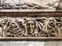 Old Carving of Face on Stone Building Royalty Free Stock Image