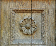 Old carving flower. Carving on old wood with crack front view Stock Photo