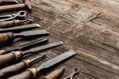 Old carving and woodworking tools. On a vintage workbench: carpentry, woodworking and craftsmanship concept royalty free stock photos