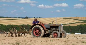Old case tractor ploughing Royalty Free Stock Photos