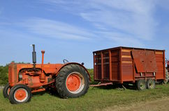 Old Case 500 tractor pulling a wagon Stock Image