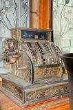 Old cash register. Ancient Money Counting Machines on a wooden table royalty free stock photography