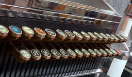 Old Cash Register with Bottle Stock Image