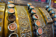 Old cash register. An old cash register with broken buttons on a lighted candy store Stock Photography