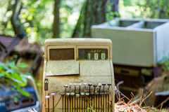 Old Cash Register in Junkyard. An old rusty cash register abandoned in a junk yard Stock Photo