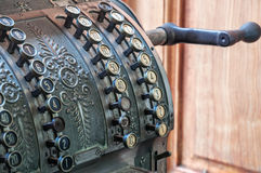 Old cash register. Old vintage cash register with buttons in the shop Royalty Free Stock Photos