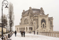 Old Casino, Constanta. The first snowfall over old Casino, on the shore at the Black Sea, in Constanta, Romania royalty free stock photo