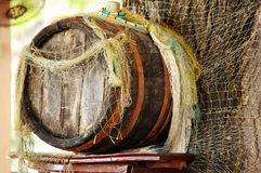 Old Cask. For wine and fish net Stock Photo