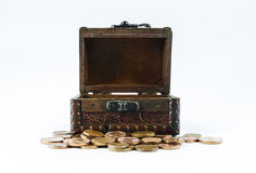Old casket and small loose change on a white background Stock Image