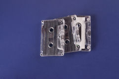 Old cassette with blue background Royalty Free Stock Photo