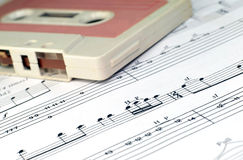 Old cassette and music notes Royalty Free Stock Photography