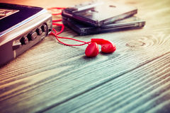 Old cassette player and tapes on a table Royalty Free Stock Photos