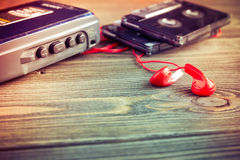 Old cassette player and tapes on a table Royalty Free Stock Photography