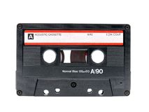 Old cassette tape. Old audio cassette tape shot over white background stock photography