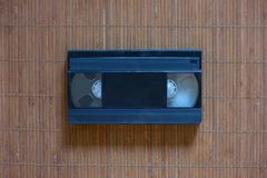 An old cassette tape of a black color video. An old cassette tape of a black and white color video stock photo