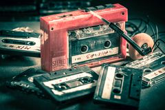 Old cassette tape with headphones and walkman. Closeup of old cassette tape with headphones and walkman royalty free stock image