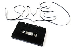 Old cassette tape isolated. the word Love from the film of the Royalty Free Stock Images