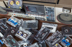 Old cassette tape recorder with cassettes. Royalty Free Stock Image