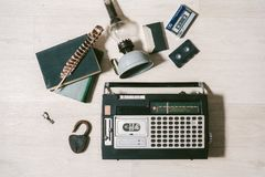Old cassette tape recorder, key, lock, oil lamp, books and feath Royalty Free Stock Image