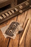 Old cassette tapes and cassette player Royalty Free Stock Photography