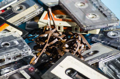Old cassette tapes on colored background Royalty Free Stock Image