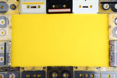 Old cassette tapes. On yellow background royalty free stock images
