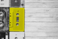 Old cassette tapes with a wooden. Background stock photography