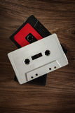 Old cassette tapes on wooden table Stock Photo