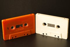 Old cassettes. On a background of a black color stock photo