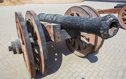 Old cast-iron cannon near the old fortress Stock Images