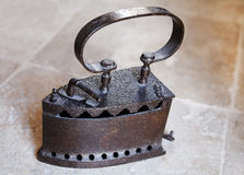 Old cast Iron clothes iron varnished Royalty Free Stock Images