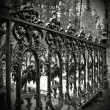 Old cast iron fence. Old very decorative unique cast iron fence stock images