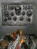 Old Cast Iron Fireplace with Log fire Royalty Free Stock Photography