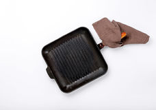 Old cast-iron grill pan on a white background Royalty Free Stock Photos