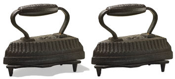 Old cast-iron iron. Old cast-iron iron to the base. Isolated Royalty Free Stock Photo