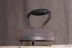 Old cast-iron iron. Old cast-iron iron to the base Royalty Free Stock Photography
