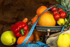 Old cast iron kitchen scale with fruit and vegetables. Healthy eating. Selling fruit. Royalty Free Stock Image
