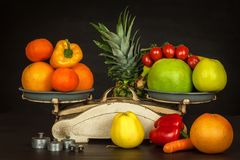 Old cast iron kitchen scale with fruit and vegetables. Healthy eating. Selling fruit. Stock Photography