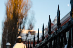 Old cast iron spiked fence in a park Royalty Free Stock Images