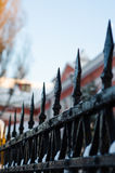 Old cast iron spiked fence in a park Royalty Free Stock Photography