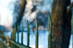 Old cast iron spiked fence in a park Stock Photo