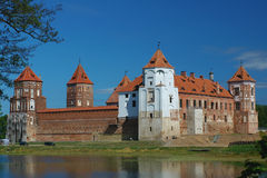 Old castle. Old red-brick castle and moat Stock Image
