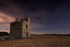 Old castle. An ancient fortification during the night, with the sky full of stars Stock Photo