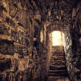 Old Castle. Long stone corridor with stairway in ancient castle Royalty Free Stock Photography