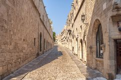 Old castle architecture building street with big wall in Rhodes royalty free stock photography